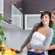 Young couple have fun in modern kitchen — Stock Photo