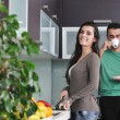 Young couple have fun in modern kitchen — Stok fotoğraf