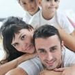 Happy young Family in their bedroom — Stock Photo #7607177