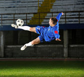 Football player in action — Stock Photo