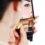 Beautiful young woman applying makeup — Stock Photo #7725142