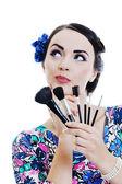 Beautiful young woman applying makeup — Stock Photo