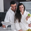Young couple have fun in modern kitchen — Stockfoto