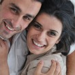 Happy young couple relax at home - Stock fotografie