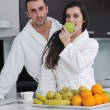 Young couple have fun in modern kitchen - 