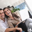Joyful couple relax and work on laptop computer at modern home — Stockfoto