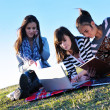 Group of teens working on laptop outdoor — Stockfoto #7830613