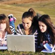 Group of teens working on laptop outdoor — 图库照片