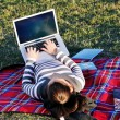 Young girl work on laptop outdoor — Stockfoto
