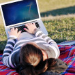 Stock Photo: Young girl work on laptop outdoor