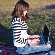 Young girl work on laptop outdoor — Stock Photo #7830746