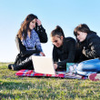 Group of teens working on laptop outdoor — Photo