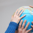 Teamwok concept with hands on globe — Stock Photo #7943004