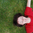 Woman laying in grass - Foto de Stock  