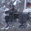Winter fun on a chair lift - Stock Photo