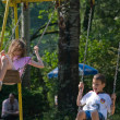 Stock Photo: Happy children swinging