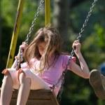 Happy girl swinging — Stock Photo