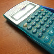 Scientific calculator on the brown table - Stock Photo