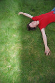Woman laying in grass — Stock Photo