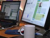 Laptop and big wide screen closeup — Stock Photo