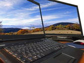 Autumn landscape on sharp dual display — Stock Photo