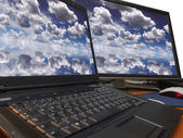 Dramatic blue sky on dual display — Stock Photo