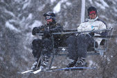 Winter fun on a chair lift — Stock Photo