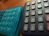 Scientific calculator on the brown table — Stock Photo