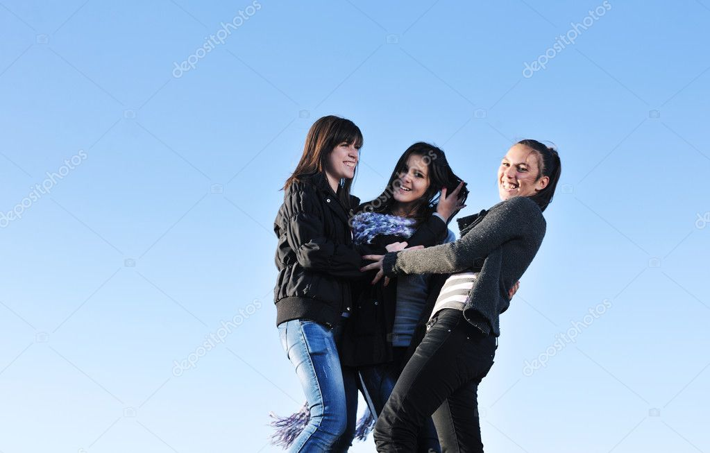 Group of teen woman  have fun outdoor with blue sky in background — Stock Photo #7941128
