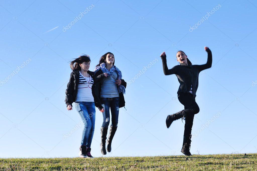 Group of teen woman  have fun outdoor with blue sky in background — Stock Photo #7941159