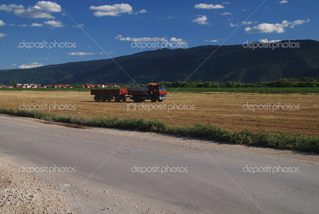 Truck on farmland — Stock Photo #7946103