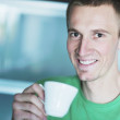 Handsome young man drink fresh morning coffee — Stock Photo