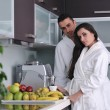 Young couple have fun in modern kitchen - Stok fotoraf