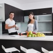 Young couple have fun in modern kitchen — Stock Photo #7951554