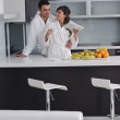Young couple have fun in modern kitchen — Stock Photo #7951576