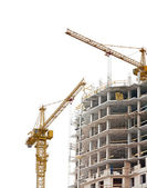 Unfinished brick house and two cranes — Stock Photo