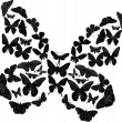 Black complicated butterfly on white — Stock Vector #7199412