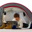 Stock Photo: Mworking with laptop in tent