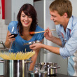 Happy young couple in the kitchen — Stock Photo