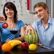 Young couple drink red wine and eat watermelon — Foto Stock
