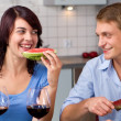 Stock Photo: Young couple drink red wine and eat watermelon