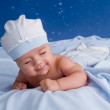 Little baby lying on the blue blanket and sliping — Stock Photo