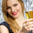 Woman with glass of champagne — Stock Photo