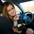 Young woman preparing her make-up in car — Stock Photo