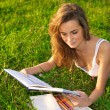 Young woman reeding on a green meadow — Stock Photo #7605266
