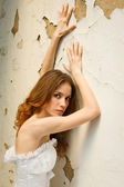 Bride on background of the old wall — Stock Photo
