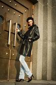Beautiful young woman near the bronze doors — Stock Photo