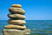 Pebble stack on seashore — Stock Photo