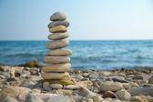Stone stack on a pebble beach — Stock Photo