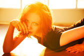 Backlight portrait of young beautiful redhead woman — Stock Photo